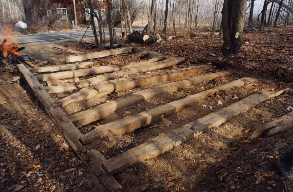 Corn Crib floor joists after frame was dismantled, 2001, Photograph by Constance Kheel
