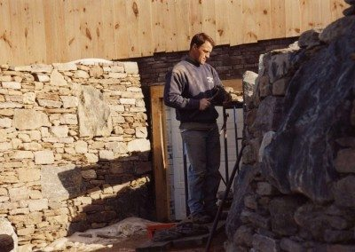 Clayton Babcock building the German Barn stone wall, 2001, Photograph by Constance Kheel