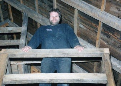 Ronald Babcock perched in the Scottish Barn's loft during restoration, 2004, Photograph by Constance Kheel