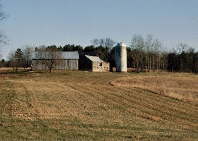 From left, Scottish Barn, Wagon Barn (subsequently disassembled), silo, and German Barn in background before restoration, 2000, Photograph by Constance Kheel