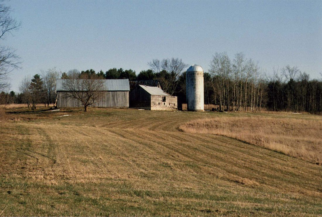 From left, Scottish Barn, Wagon Barn (subsequently disassembled), silo, German Barn in background, 2000, Photograph by Constance Kheel