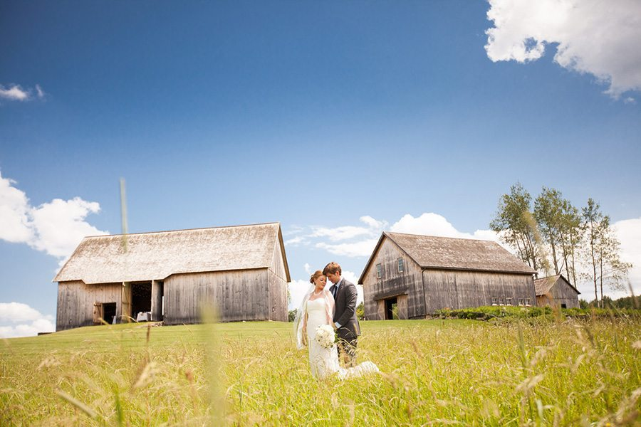 Bride and groom pose at award-winning wedding barn venue, Meghan Baker Photography