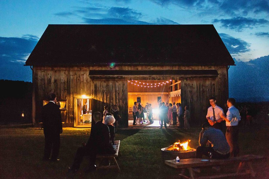Guests gather by campfires during a wedding reception, Our Two Hearts