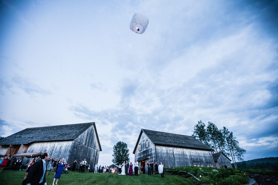The couple releasing a fire sky lantern during a Nipmoose wedding, Meghan Baker Photography