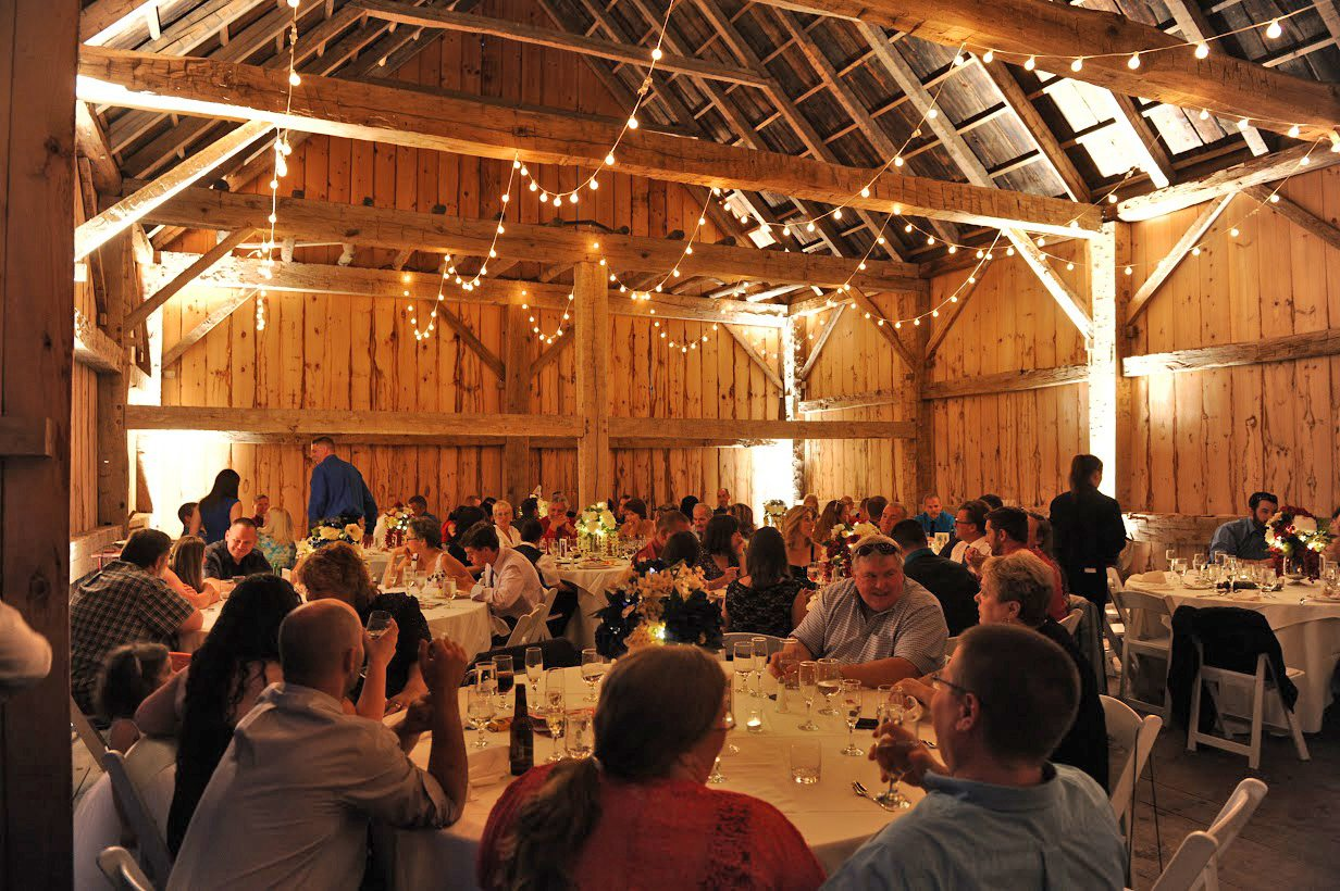 Guests enjoying the wedding reception in the Scottish Barn, McGarry Photography